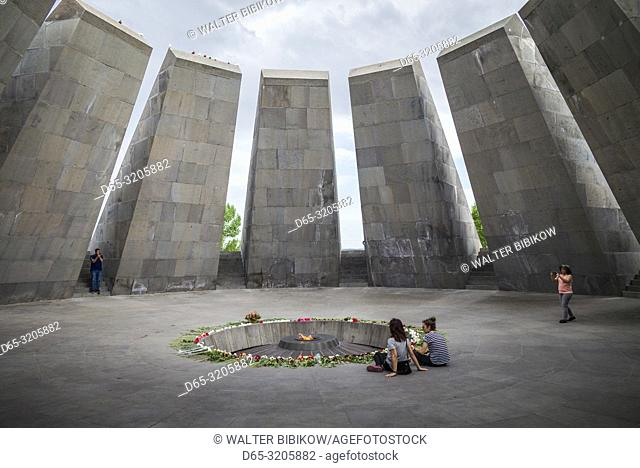 Armenia, Yerevan, Armenian Genocide Memorial, monument to the massacre of Armenians of the Ottoman Empire, 1915-1922, eternal flame, with visitors, NR