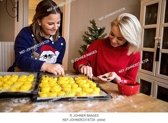 Two women preparing rolls