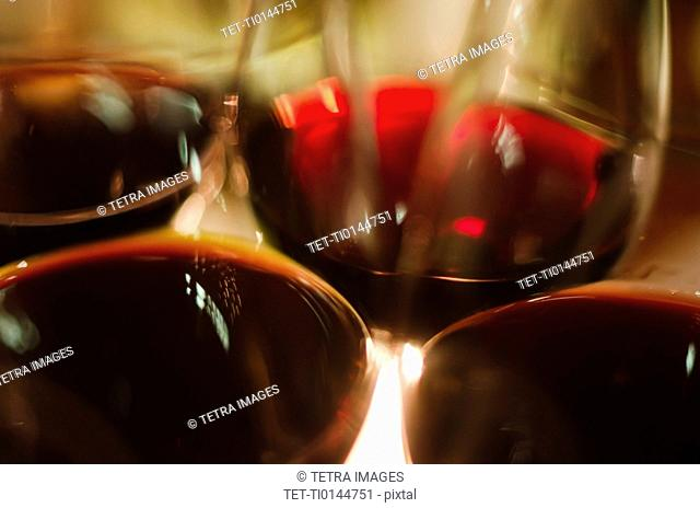 Close-up view of red wine glasses