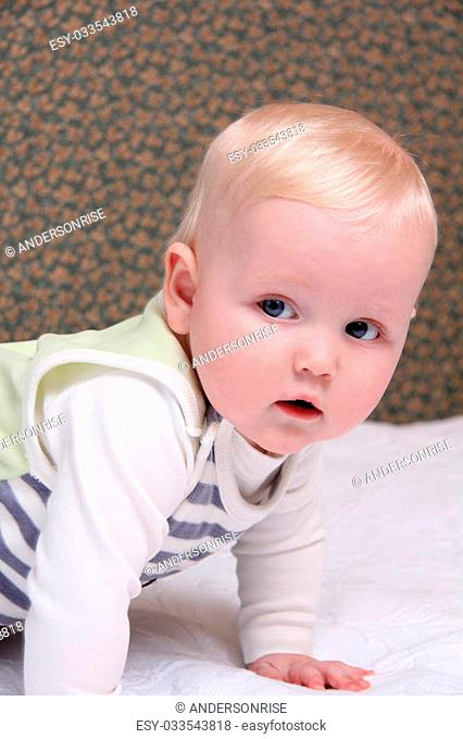 Closeup six month old baby blonde boy