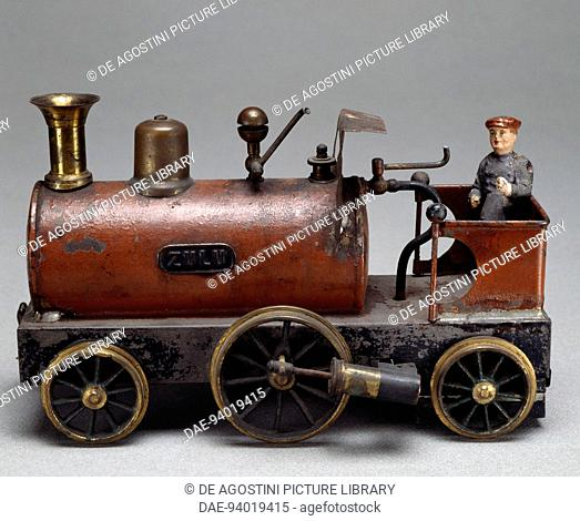 Steam locomotive, toy operated with steam boiler. England, 20th century.  Milan, Museo Del Giocattolo E Del Bambino (Toys Museum)