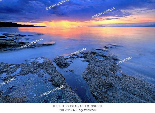 Long exposure shoreline scenic over Georgia Strait, north Nanaimo, Vancouver Island, British Columbia