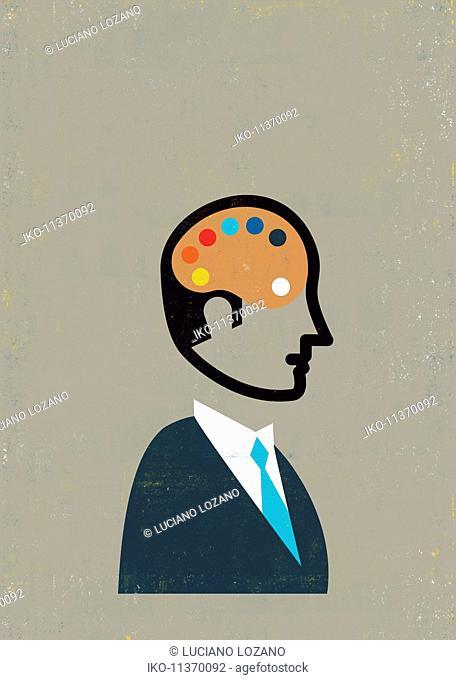 Businessman with artist palette inside of head