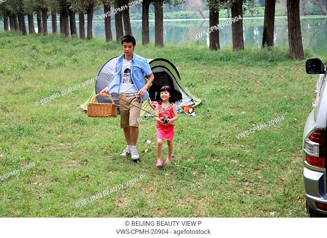 girl with her father on camping