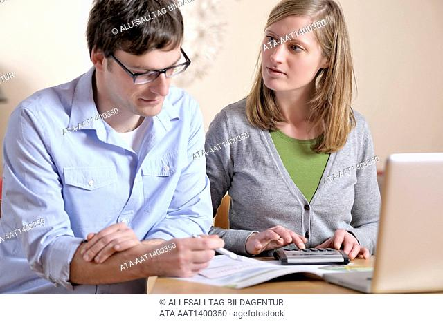 Couple is checking their finances