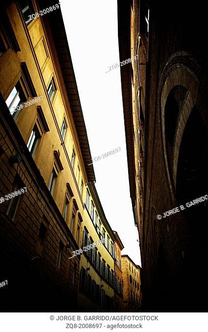 Narrow medieval street in Siena, Italy