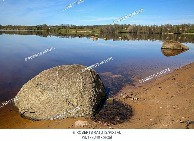 Natural big river Daugava landscape with natural big stones and ruins in Latvia. Koknese castle ruins. Latvian medieval castles