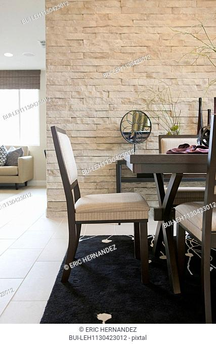 Table and chair in dining area of middle class house