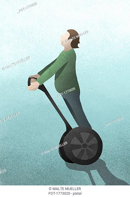 Man riding Segway scooter on blue background