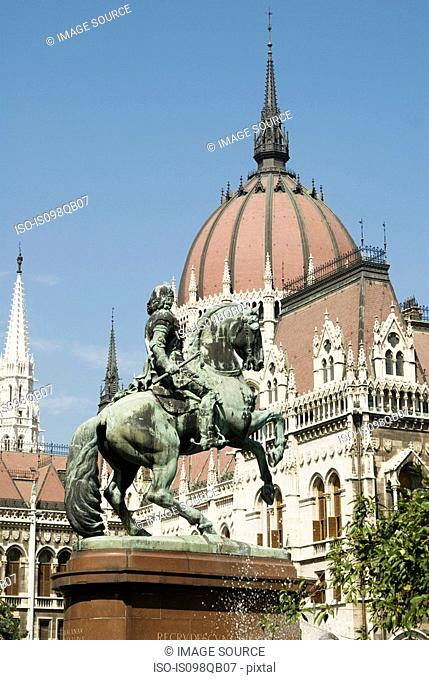 Statue and hungarian parliament building