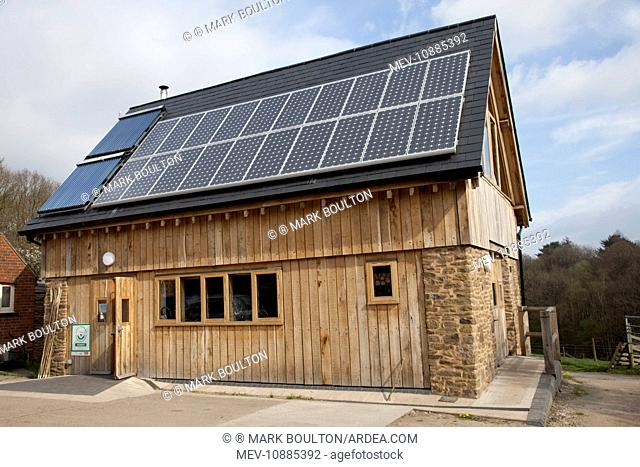 Solar Thermal and PV panels - on roof of sustainable oak timber building . Ruskin Studio - Wyre Forest - Bewdley - UK