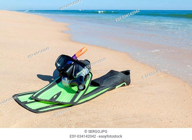 Fins, snorkel, mask for diving. On the beach the sea