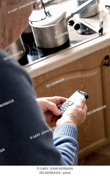 Senior woman using cellular phone