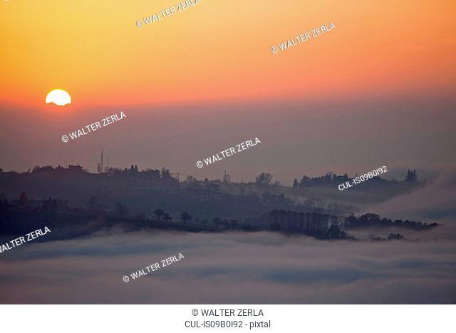 Valley fog at dusk, Langhe, Piedmont. Italy