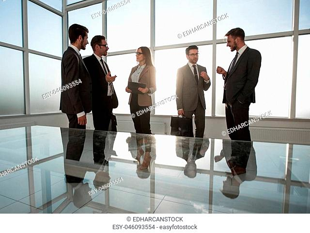 photos of businessmen in a conference room with morning light