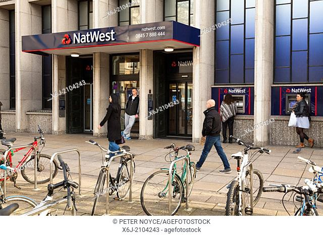 Exterior of NatWest bank Portsmouth branch with ATM and bicycle rack