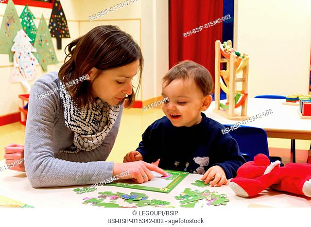 Reportage in a nursery in Fay de Bretagne, France. A child care assistant