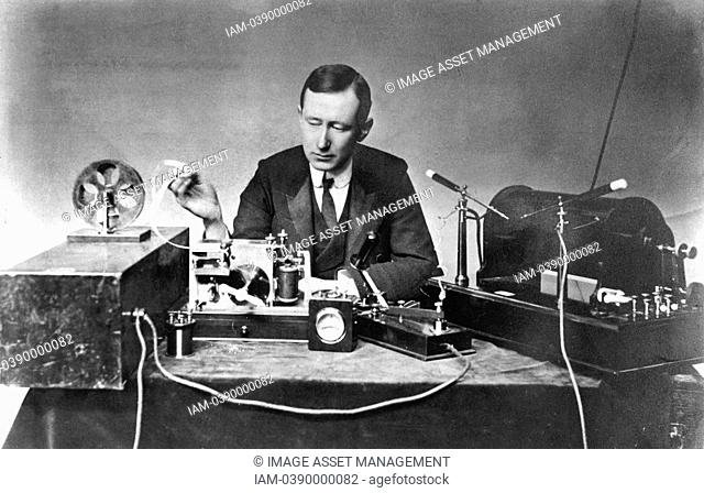 Guglielmo Marconi 1874-1937, Italian physicist and inventor. Radio pioneer. Marconi with typical apparatus, including 10-inch induction coil spark transmitter...