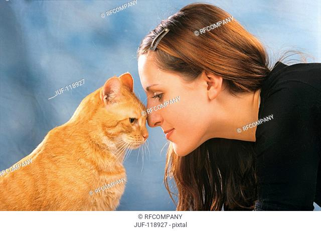 young woman and cat - head-to-head
