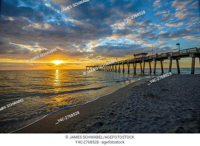 Sunset over Gulf of Mexico and Venice Pier from the baech in Venice on the Gulf Coast of Florida