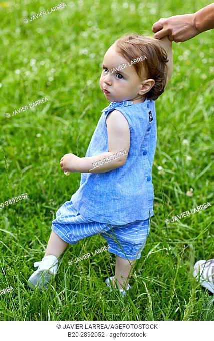 Baby walking in the garden, Gipuzkoa, Basque Country, Spain, Europe