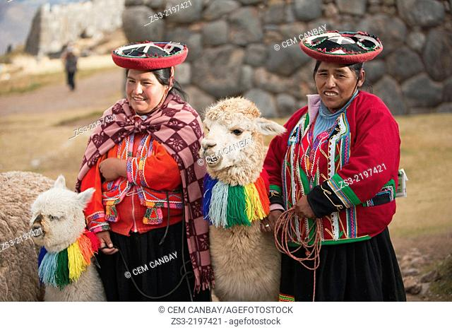 Quechua-Peruvian women with traditional costume and llamas near Cusco, Saqsaywaman, Cusco, Peru, South America