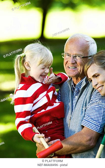 Senior man girl and woman in the park Sweden