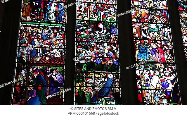 Interior, CU, TILT up, view of the Oxford Cathedral. Seen is the Saint Frideswide stained-glass window, made in 1859 by Burne-Jones