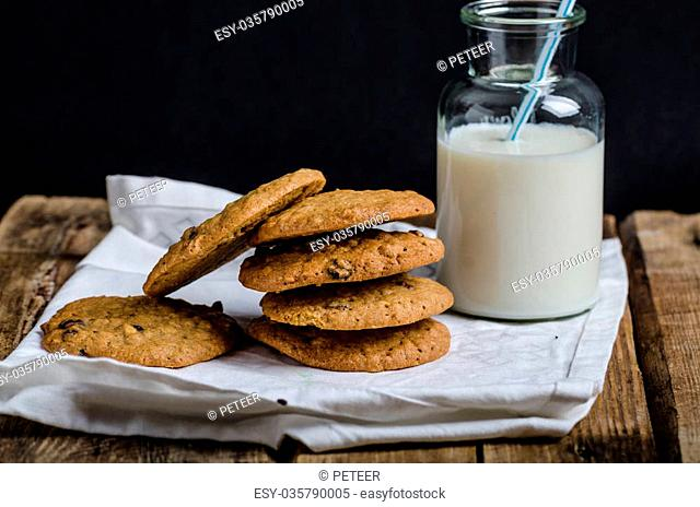 Homemade Oatmeal Cream Pie cookies, with bio milk, black background for your advertisment, text