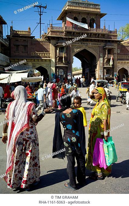 Indian women shopping, street scene at Sardar Market at Girdikot, Jodhpur, Rajasthan, Northern India