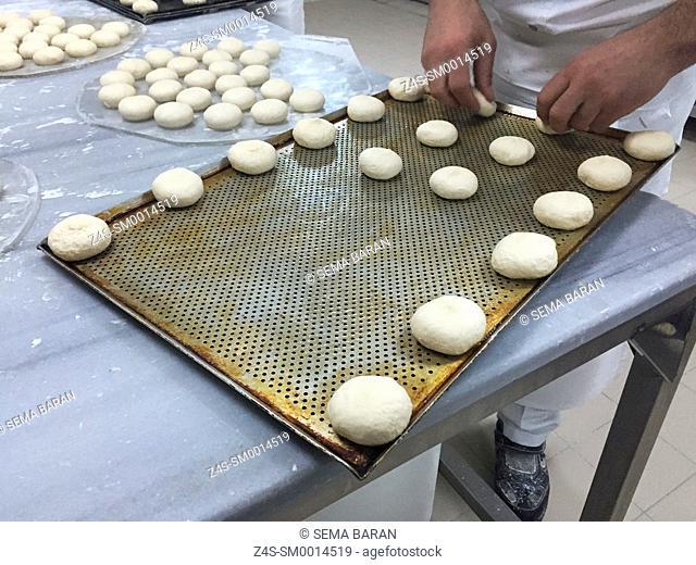 Turkish cooks making little bread loafes, Taksim, Istanbul, Turkey, Europe