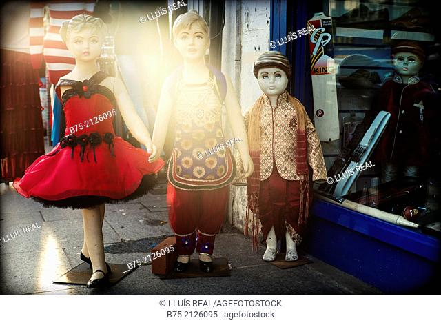 Three children mannequins dressed in Hindu style, outside a shop in Southall, London, England, UK