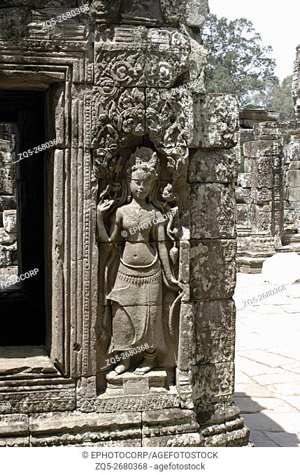 Cambodia, Angkor Wat 12th century A. D. Standing Apsara on the left of the doorway