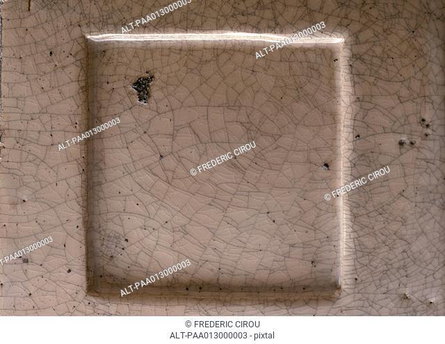 Raised square tile, close-up, full frame