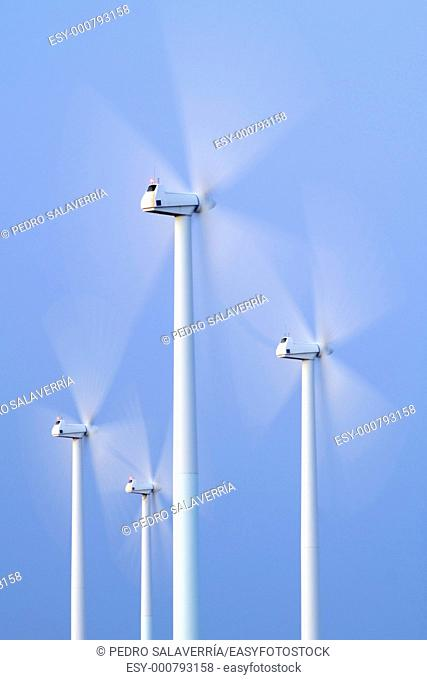 blades of a group of modern windmills turning in La Muela, Saragossa, Aragon, Spain