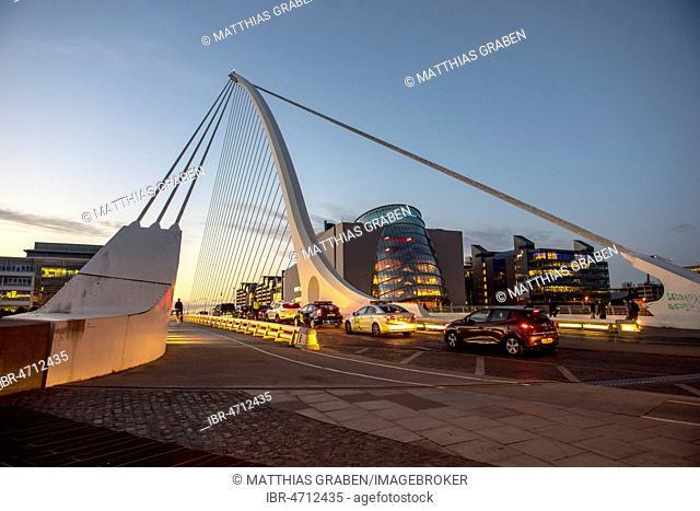 Cars on Samuel Beckett Bridge, cable-stayed bridge and swing bridge over the river Liffey, blue hour architect Santiago Calatrava, Dublin, Republic of Ireland