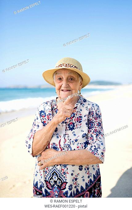Portrait of senior woman standing on the beach