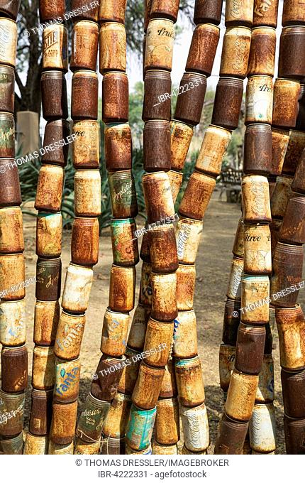Fence made of old, rusty tins in the garden of a restaurant, recycling, Omaruru, Namibia