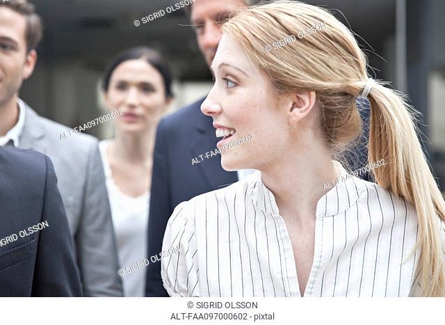 Businesswoman looking at associate