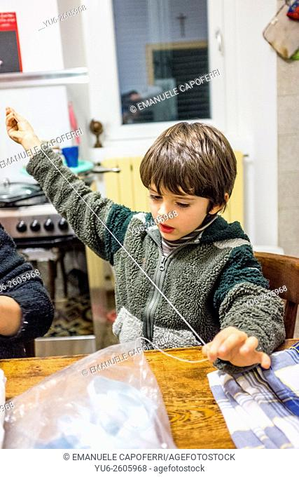 Child sews at home
