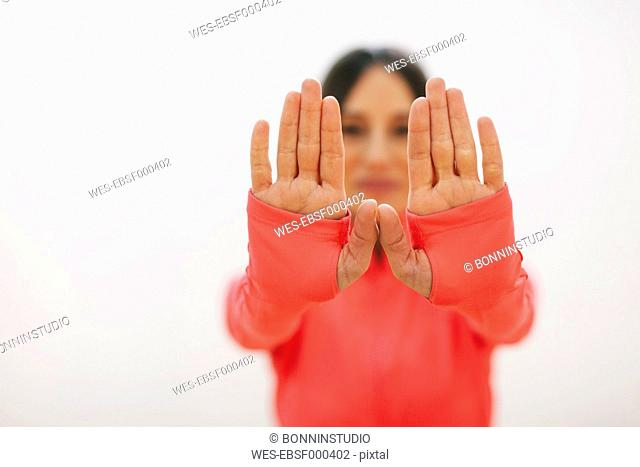 Hand's of young woman doing fitness workout