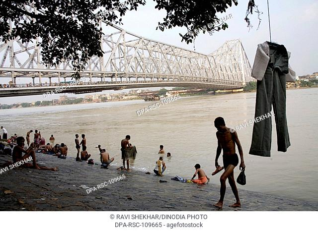 View of Howrah Bridge now Rabindra Setu from bank of river Hooghly ; Calcutta Kolkata ; West Bengal ; India