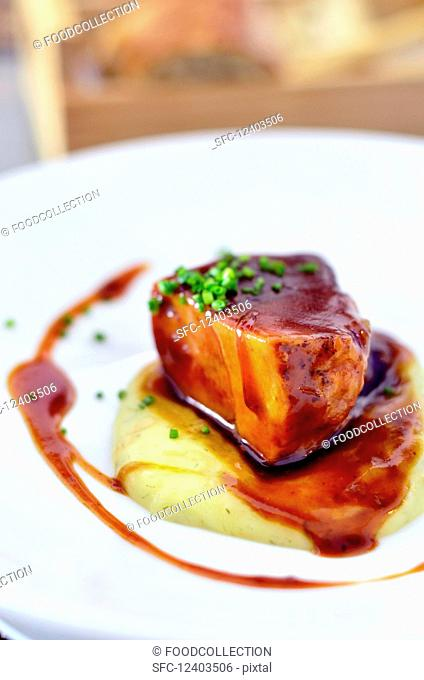 Braised Iberico pork belly with gravy on a bed of mashed potato