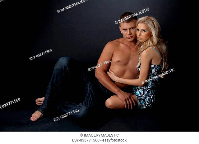 Young caucasian couple in front of camera