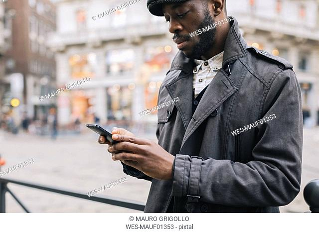 Man in the city checking cell phone