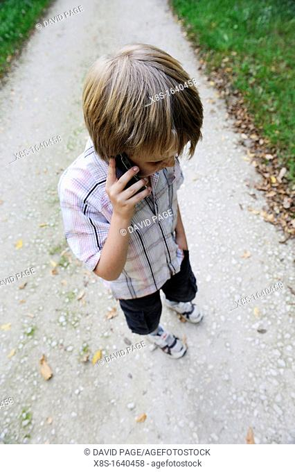 11 year old boy talking onhis mobile phone