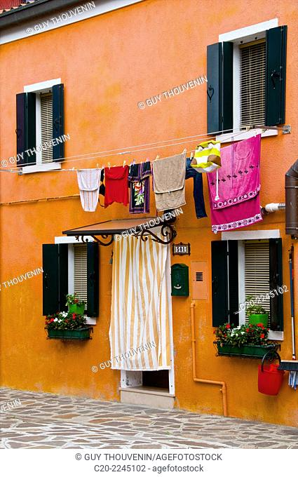 Fishermen's colored facade houses, Burano, with drying washing, Venice, Italy