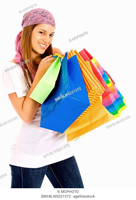 young cute woman holding several colourful shopping bags