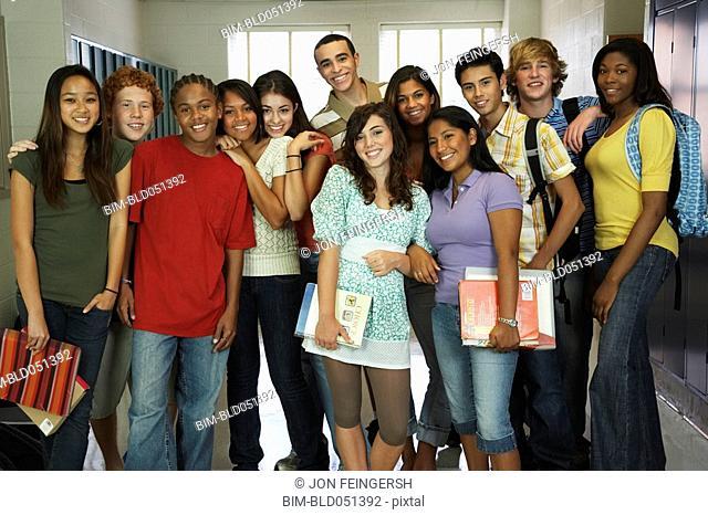 Group of multi-ethnic teenagers in school hallway