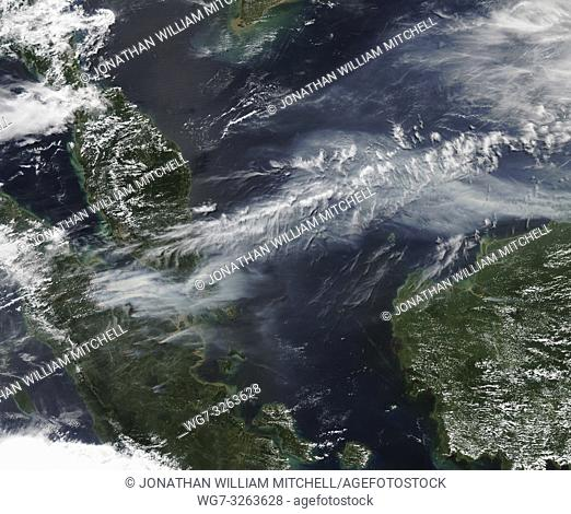 Smoke billows from illegal wildfires on the Indonesian island of Sumatra. The smoke blew east toward southern Malaysia and Singapore